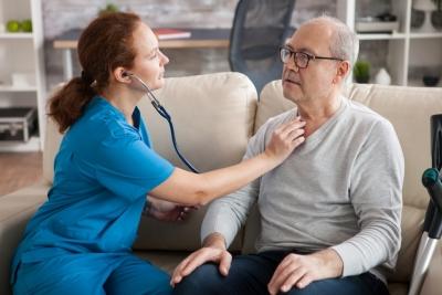 nurse checking senior man