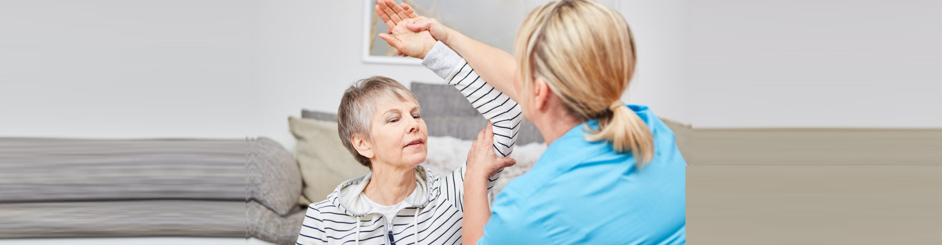 physiotherapist makes occupational therapy exercise with senior man
