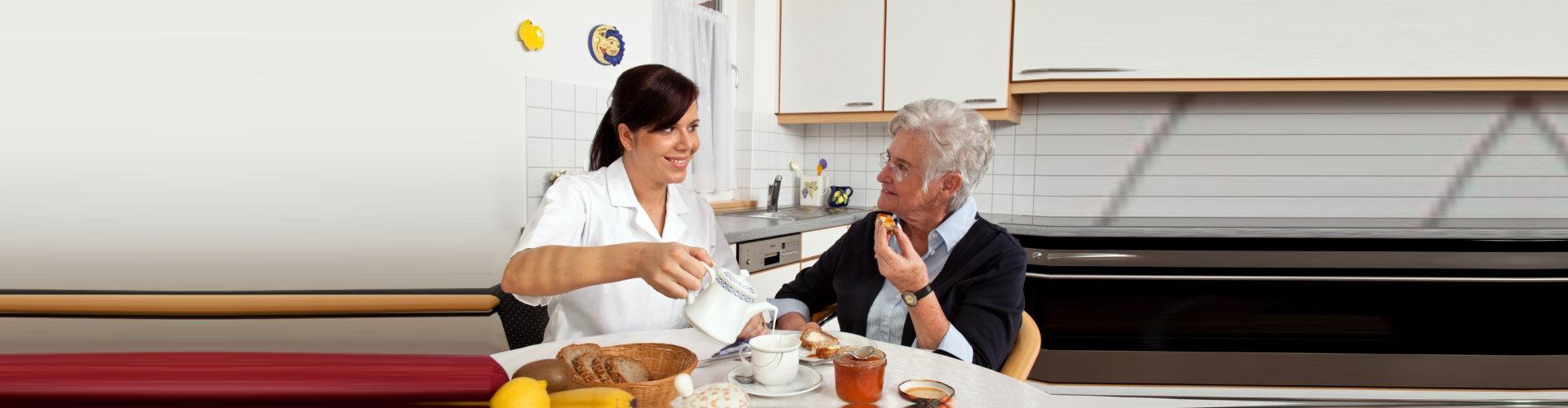 caregiver serving elder woman